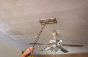 picture of a devise held into a ceiling vent