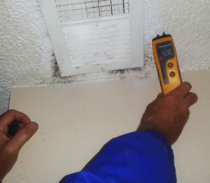 Testing tool being held near air vent